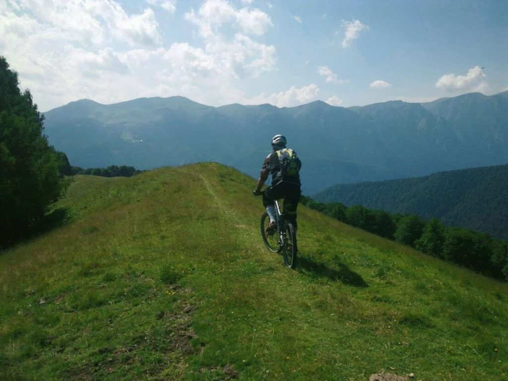 Person biking in the mountains surrounding Brasov, a great day trip.