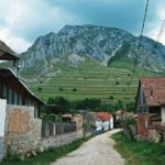 Szelek village in Transylvania with mountain backdrop.