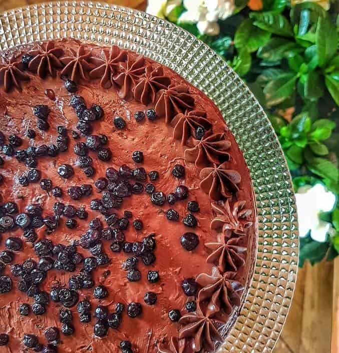 Homemade chocolate Joffre Cake on a clear crystal dish, a traditional Romanian dessert.