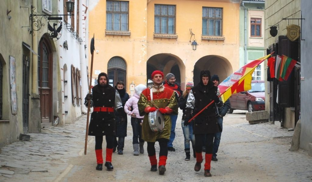 Group of people dressed in medieval attire during the annual festival in Sighisoara, Romania.