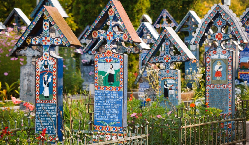 Colorful gravemarkers at the Merry Cemetery in Transylvania, Romania